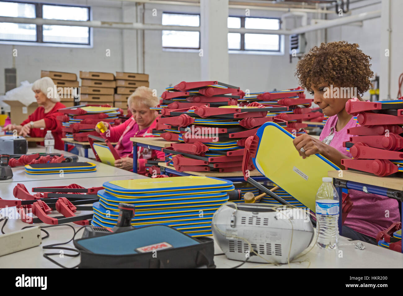 Louisville, Kentucky - Workers assemble educational aids for the blind at the American Printing House for the Blind. - Stock Image