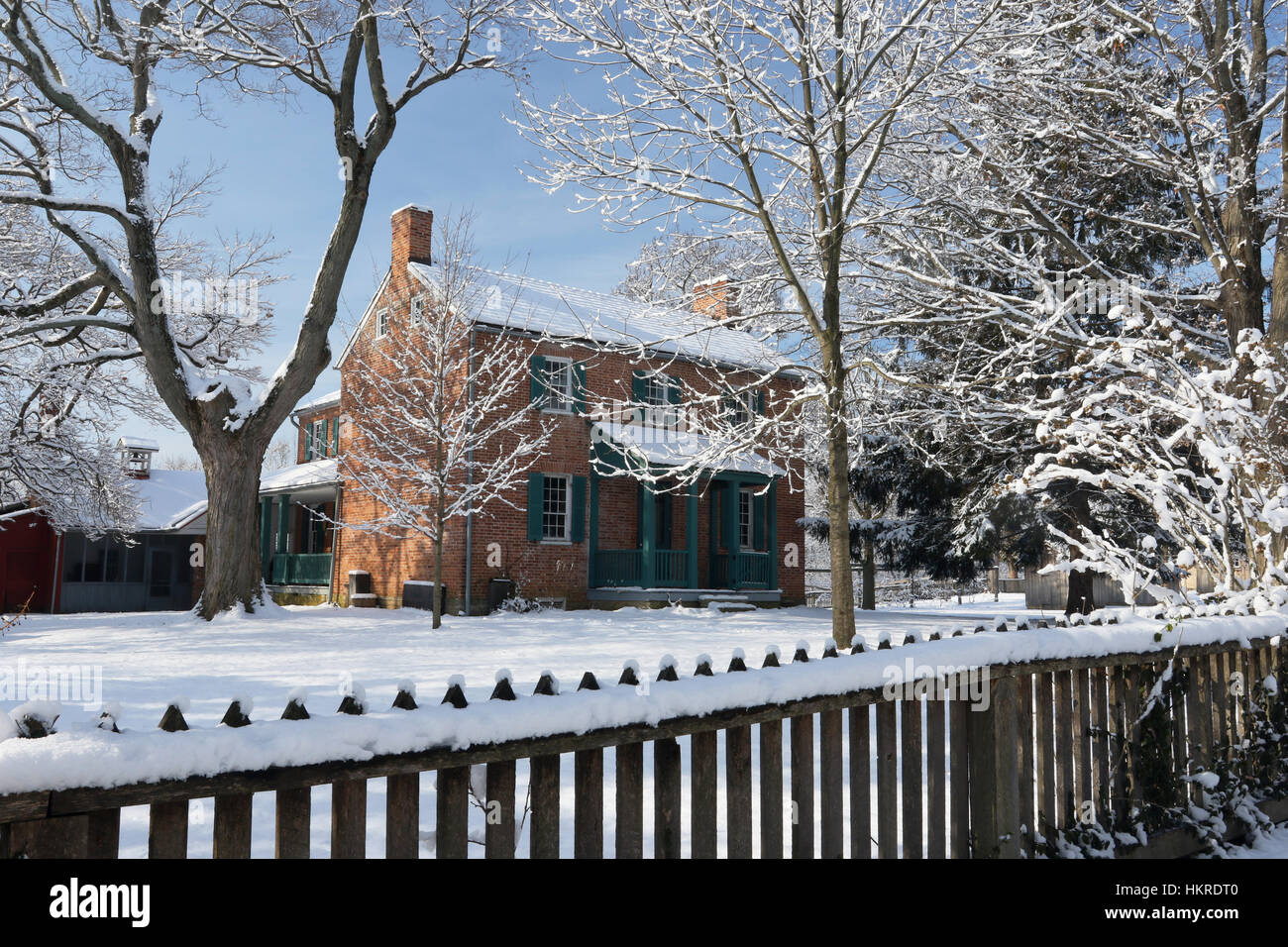 Daniel Arnold House in Winter. At Daniel Arnold Historical Farm, Carriage Hill Metropark, Huber Heights, Dayton, - Stock Image