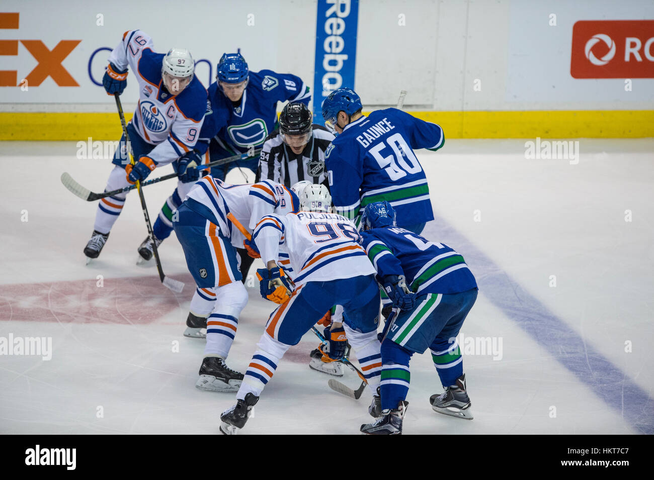 Edmonton Oilers and Vancouver Canucks have a faceoff, Rogers Arena Vancouver British Columbia - Stock Image