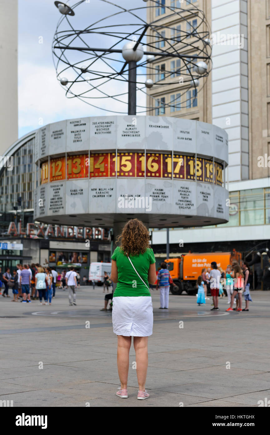 The rotating World Clock and small planets in Alexanderplatz in Berlin, Germany. - Stock Image