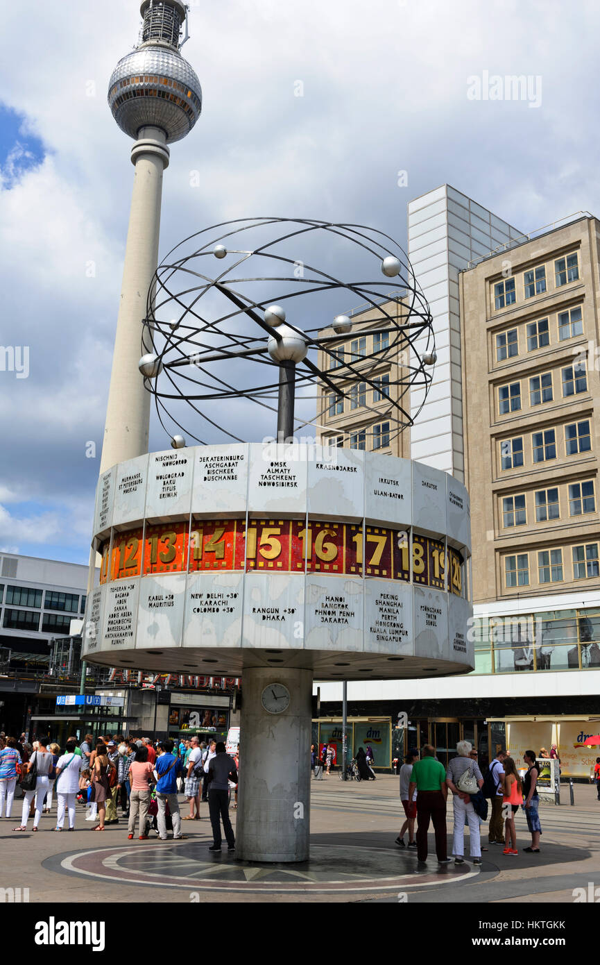 The rotating World Clock with small planets above and the Television Tower in the distance in Alexanderplatz in - Stock Image