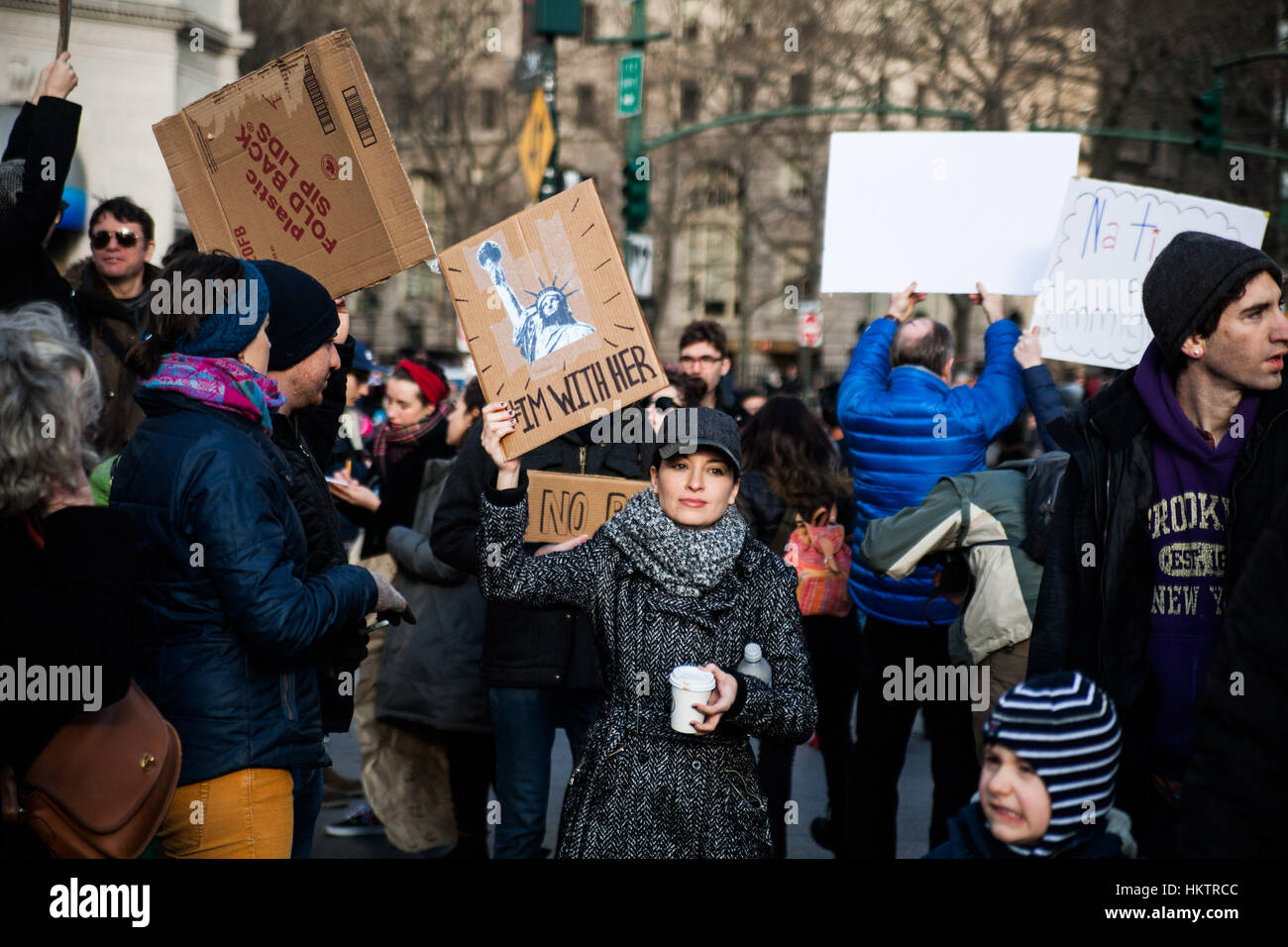 New York City, USA. 29th Jan, 2017. Protestors demonstrate against American President Donald Trump's immigration Stock Photo