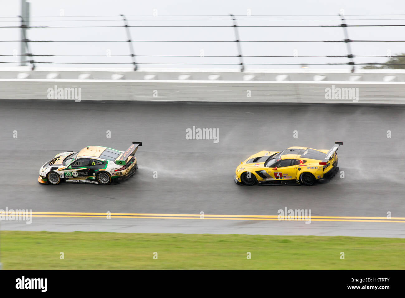 Daytona Beach, USA. 29th January, 2017. Drivers battle overnight rain and wet track conditions at the Daytona International Stock Photo