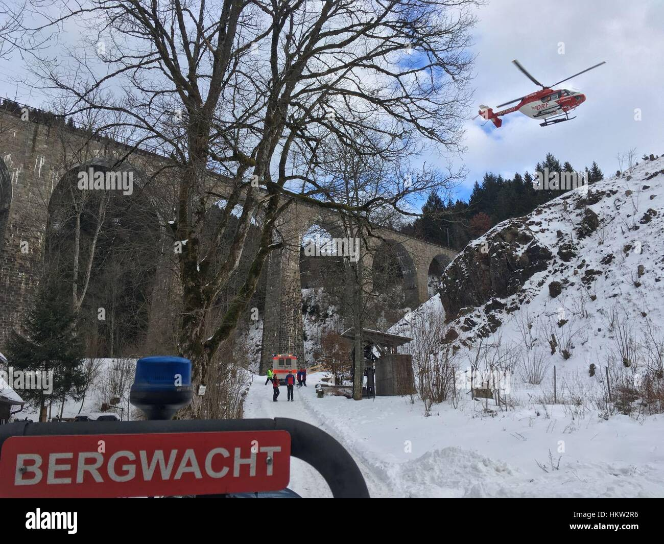 Breitnau, Germany. 29th Jan, 2017. HANDOUT - Rescue helicopter Christoph 54 lands at the Ravenna gorge near Breitnau, - Stock Image
