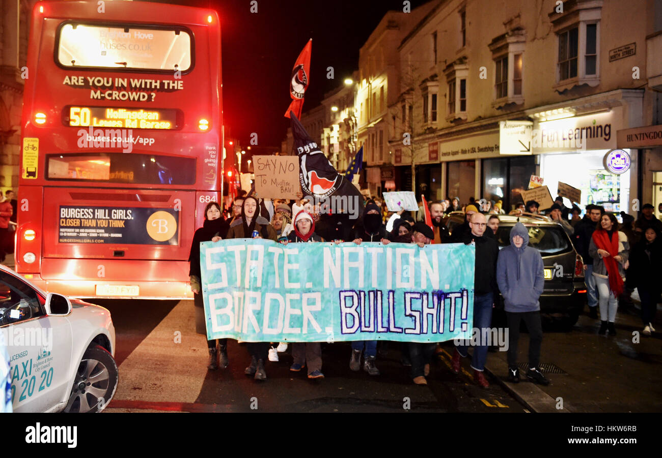 Brighton, UK. 30th Jan, 2017. Thousands of people march through Brighton as they take part in an Anti-Trump Protest - Stock Image