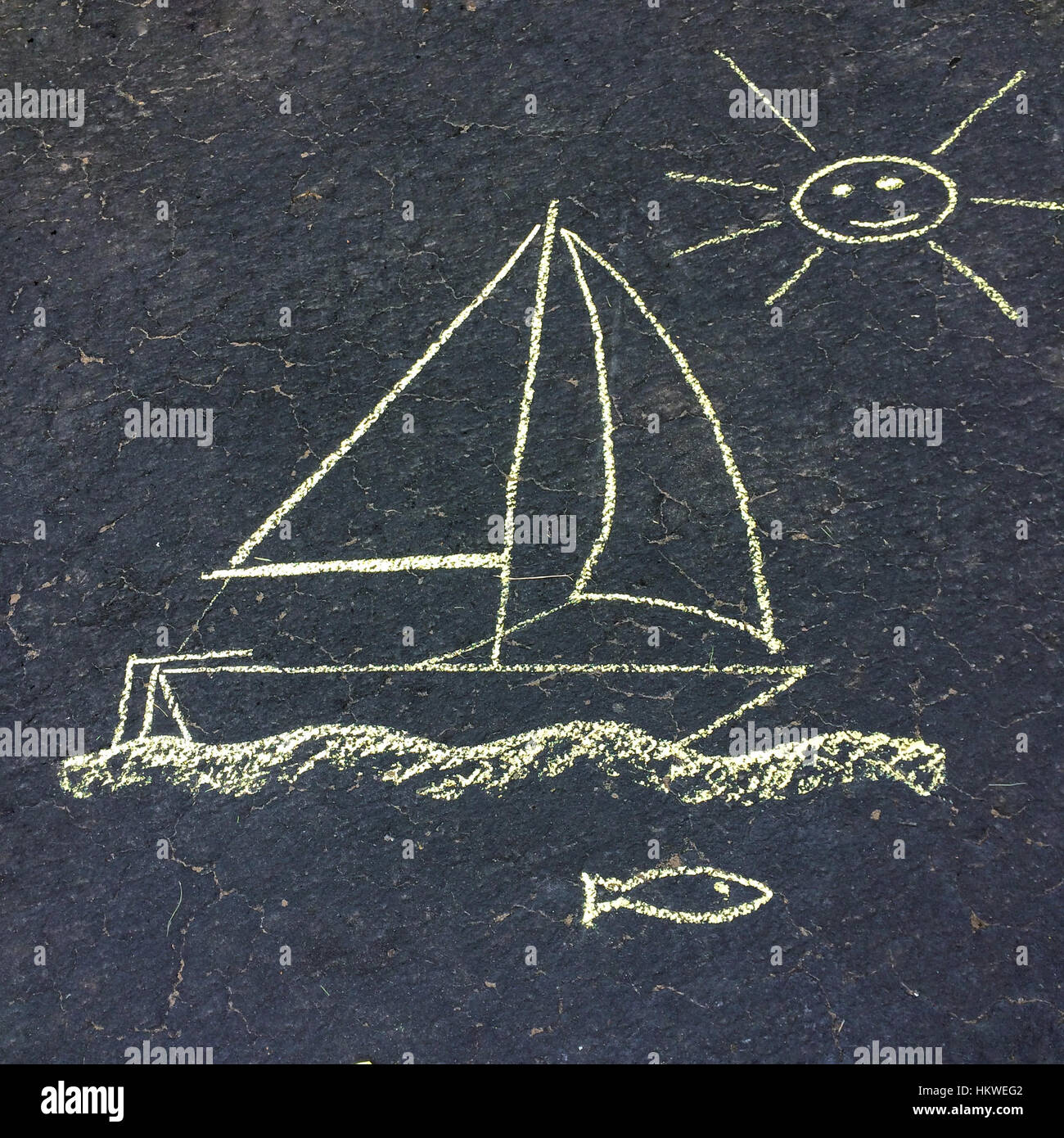 Chalk drawing on an asphalt driveway - Stock Image