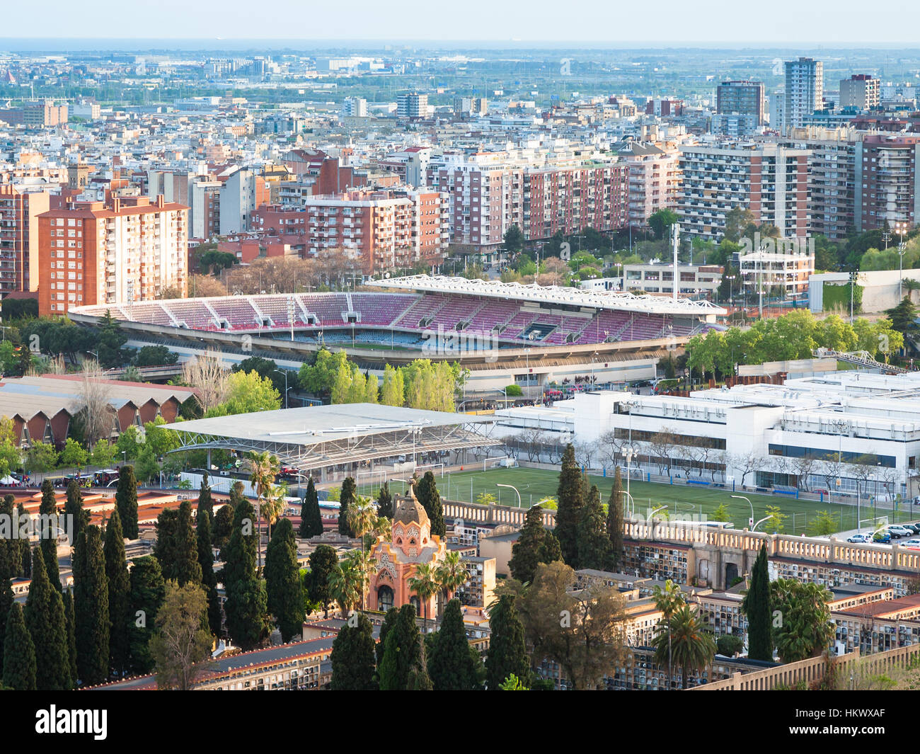 Barcelona cityscape with Camp Nou stadium and cemetery in evening - Stock Image