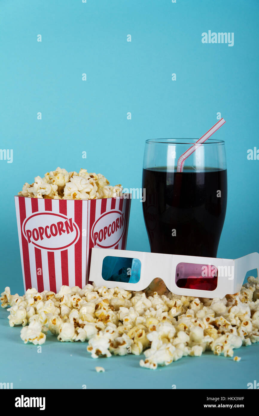 Bucket Of Popcorn Against A Blue Background Stock Photo Alamy