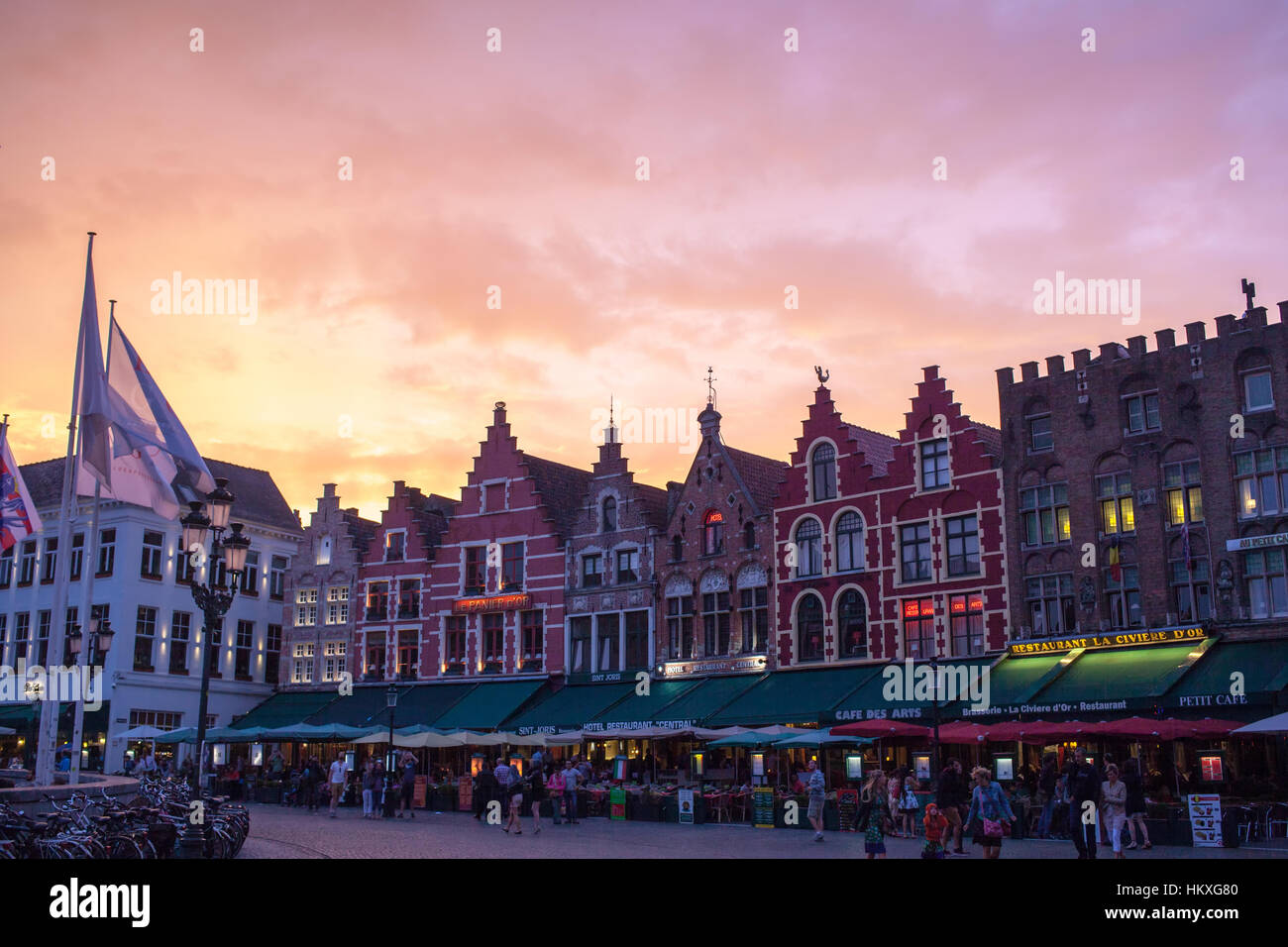 buildings in the Market Square on sunset in Bruges, natural light. They are not really medieval but mostly modern - Stock Image