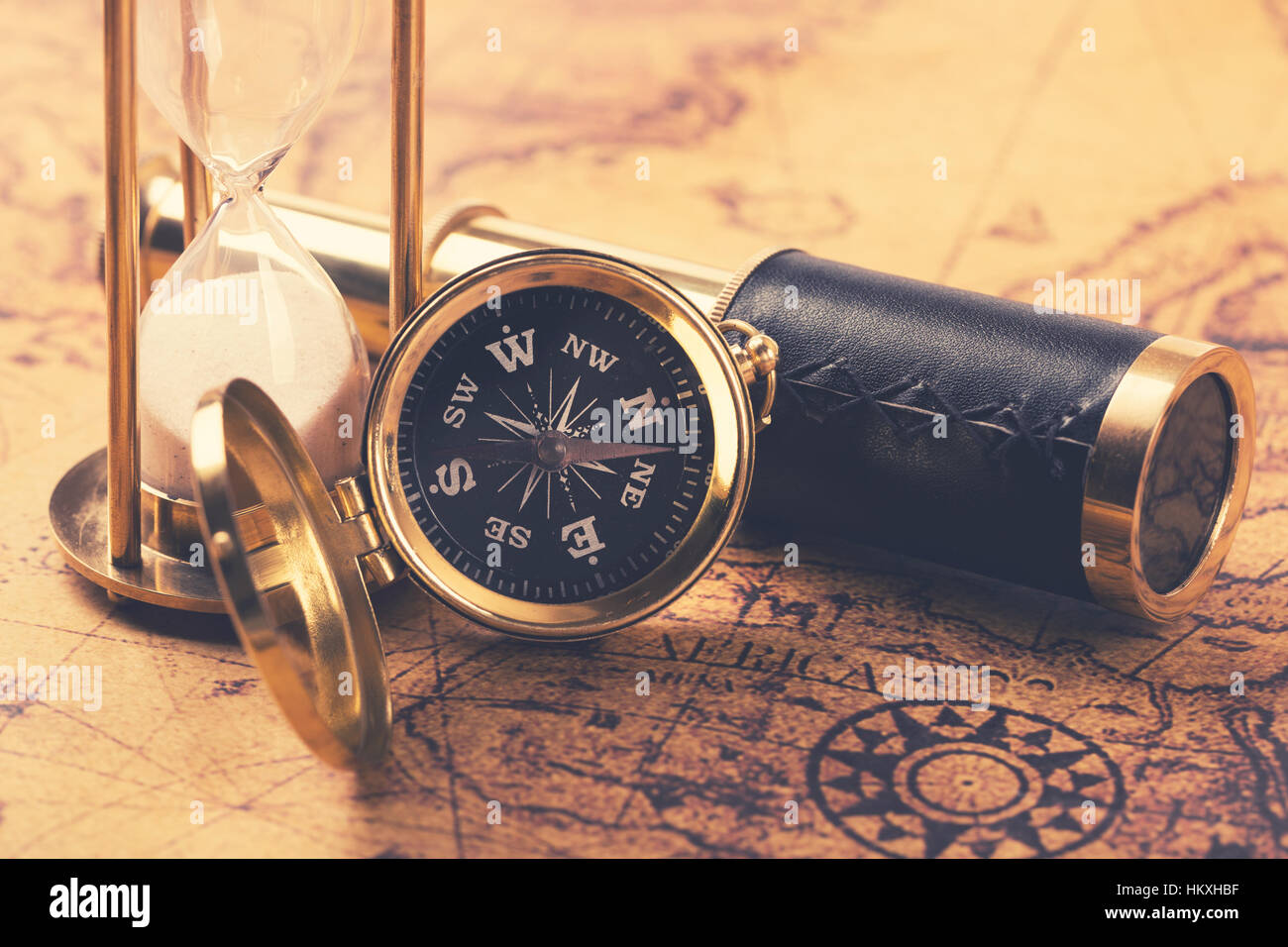 compass and nautical vintage equipment on old world map - Stock Image