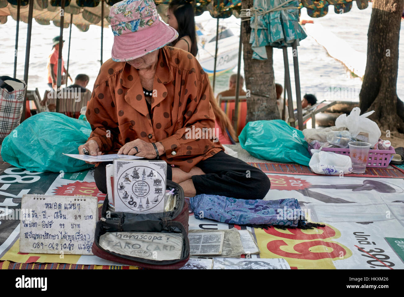 Female Tarot card reader and fortune teller. Thailand Southeast Asia - Stock Image