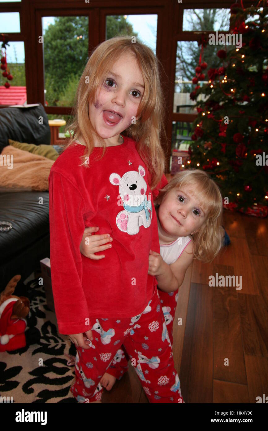 Blonde Children, kids playing with makeup on Christmas Morning Stock ...