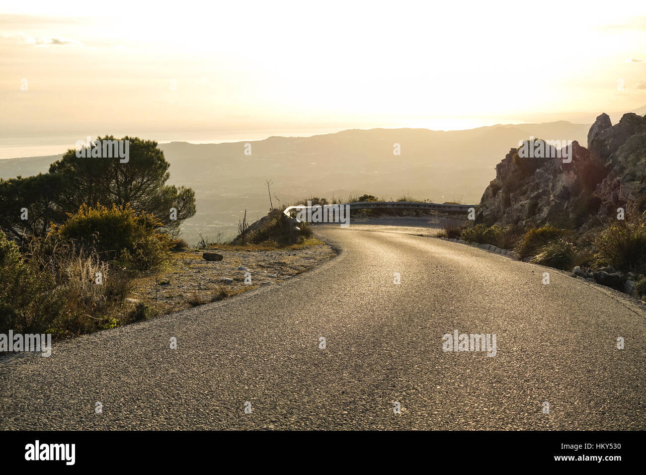 Empty winding road in mountains of southern Spain. - Stock Image
