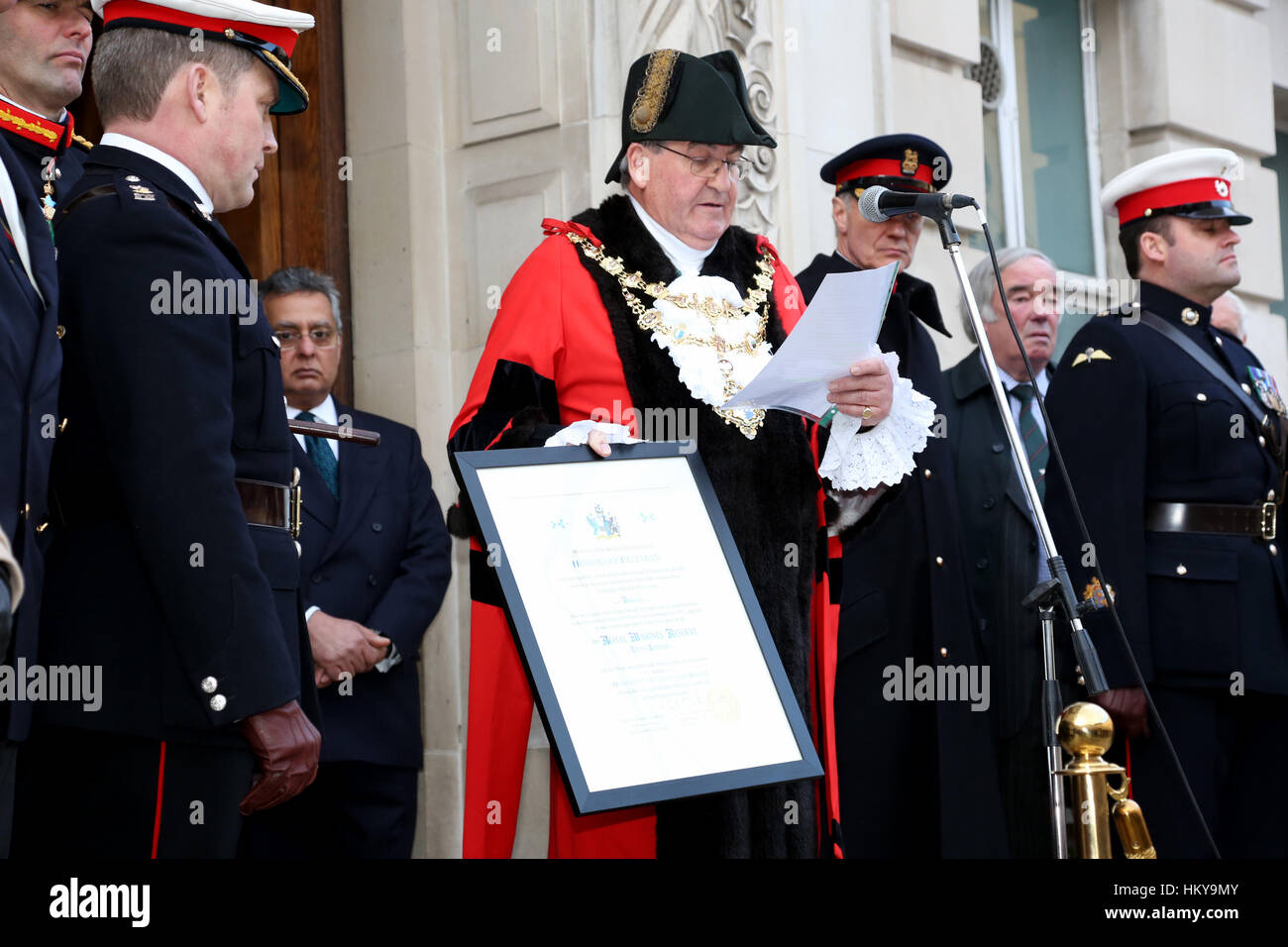 Mayor of wandsworth  cllr richard field reads the citation before he hands the certificate of the freedom of the - Stock Image