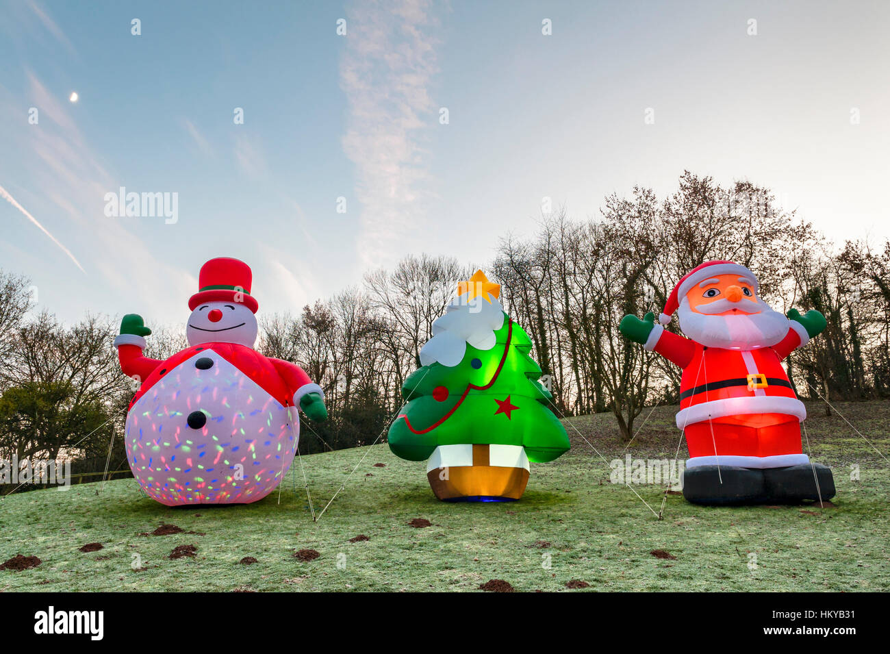Huge illuminated inflatable Christmas figures stand in a frosty field in rural Herefordshire, UK. - Stock Image