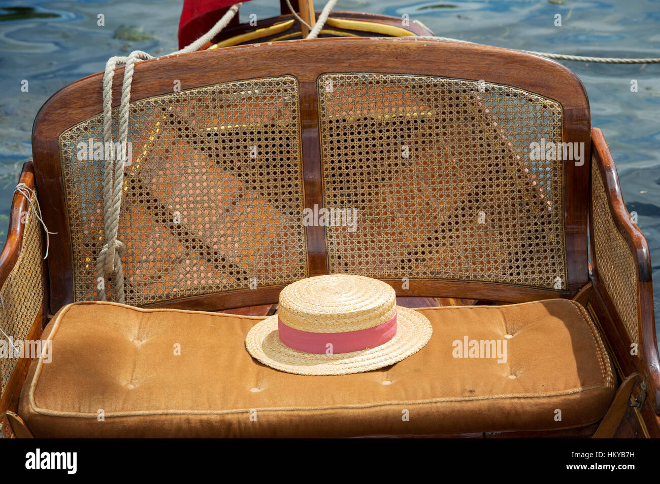 Straw boater on a wooden rowing boat at Henley on Thames boating festival. Henley On Thames, Oxfordshire, England - Stock Image