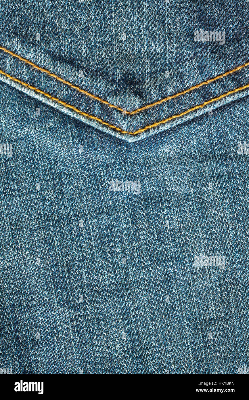 Close up picture of blue jeans fabric with stitches, background or texture. - Stock Image