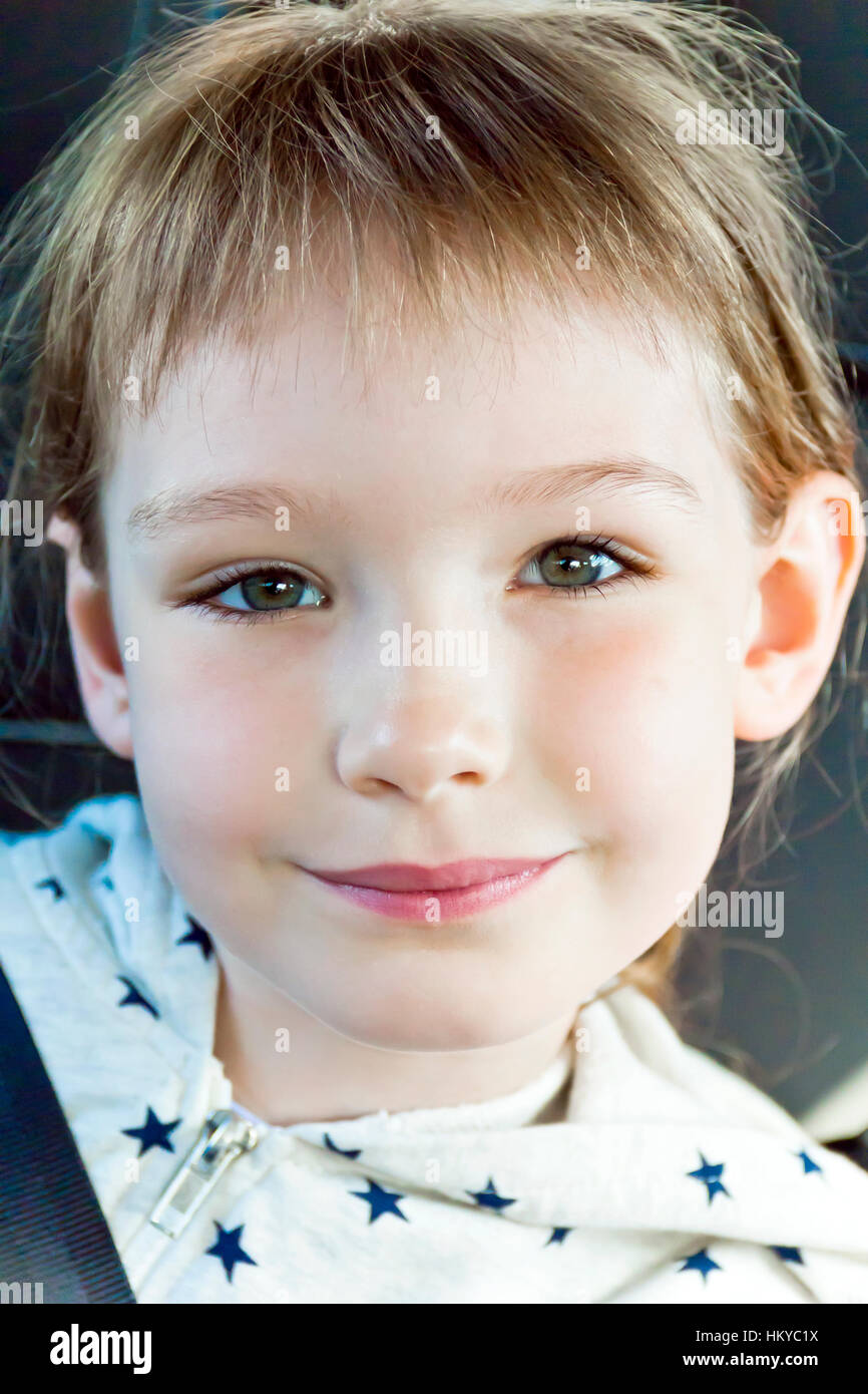 Portrait of cute girl eight years old - Stock Image