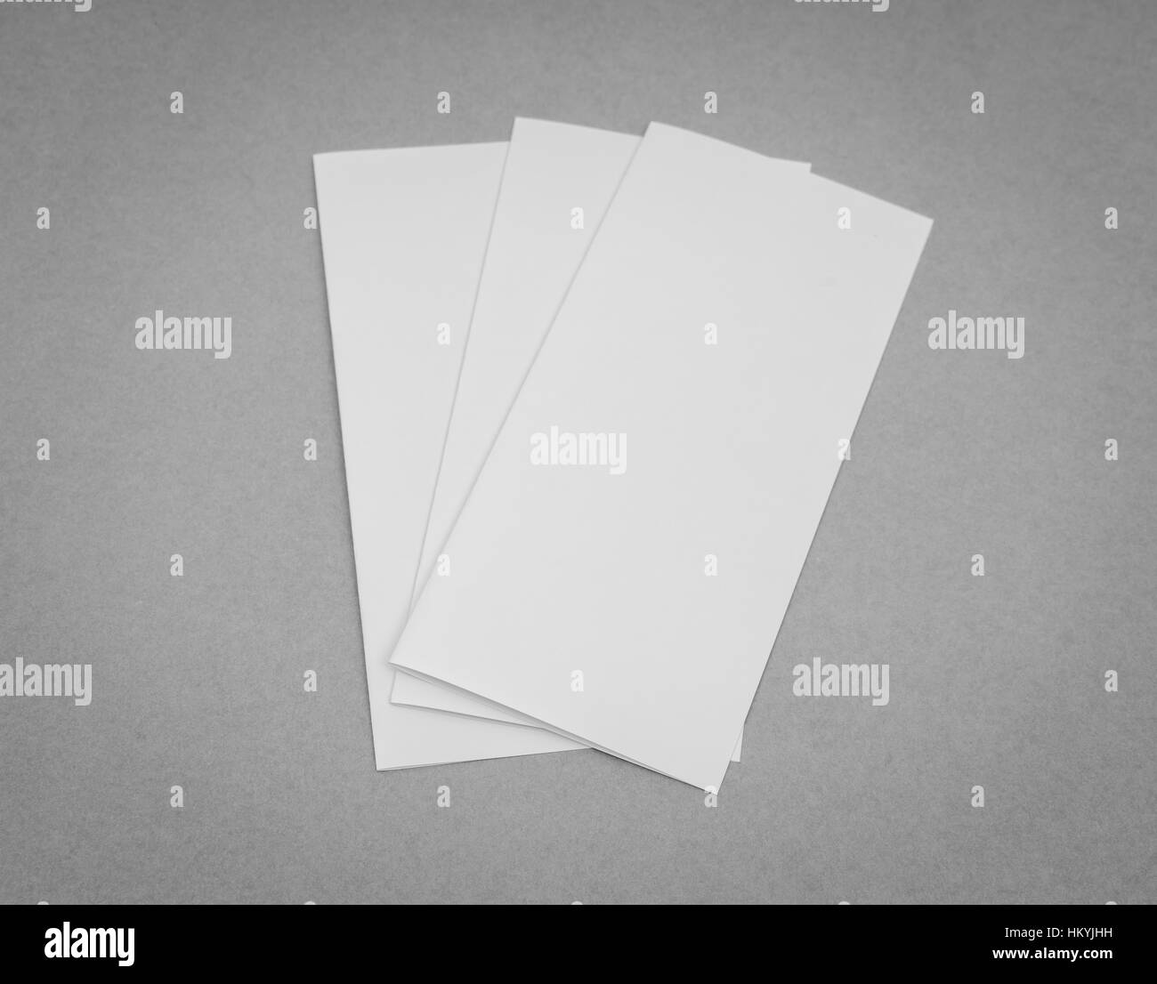 bifold white template paper on gray background stock photo