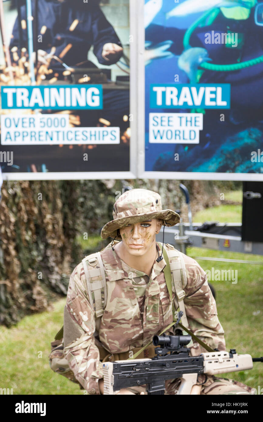 British Army recruiting boards and mannequin dressed in camouflage uniform with SA80 rifle - Stock Image
