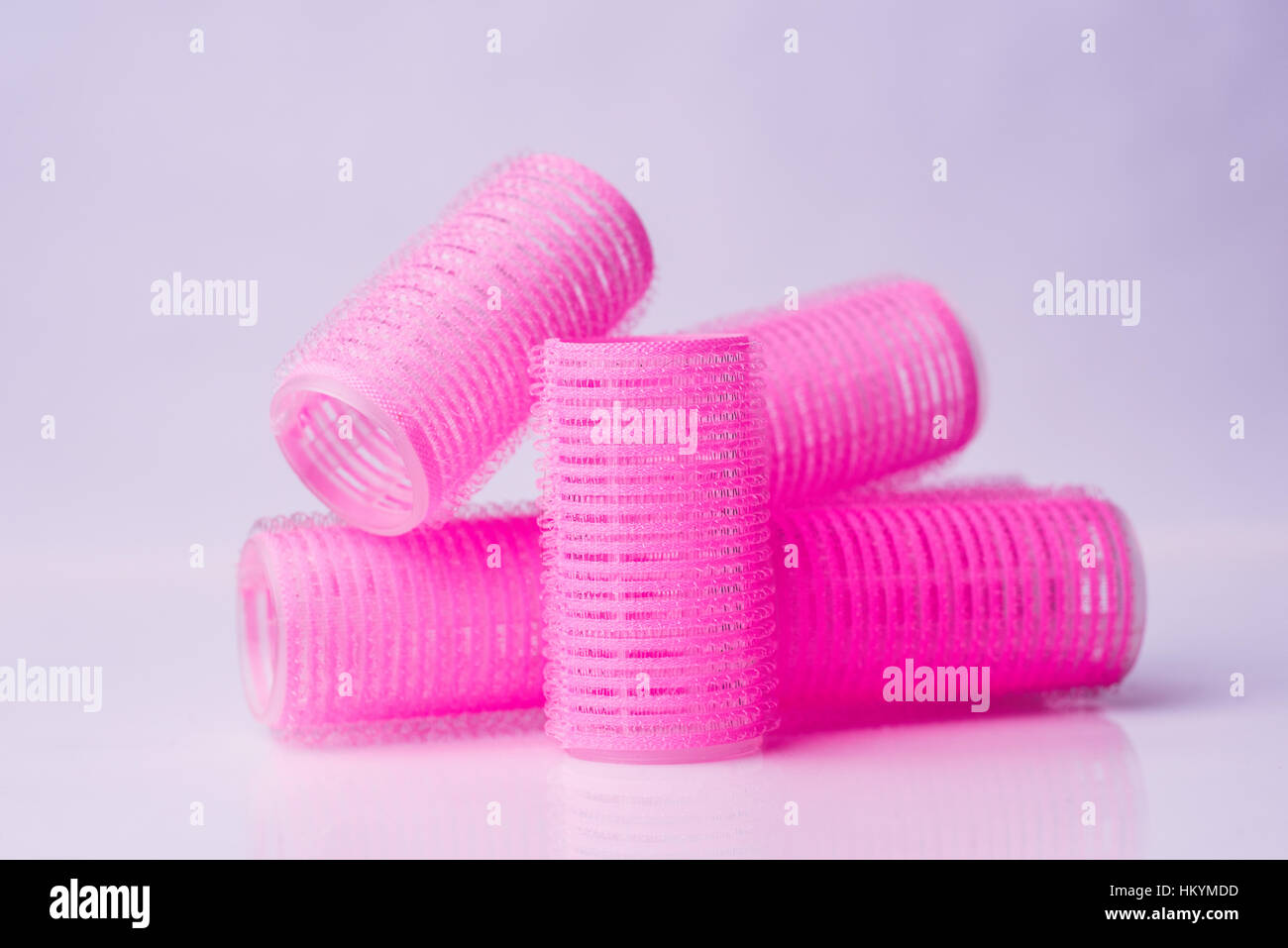 Hair curlers on white background - Stock Image