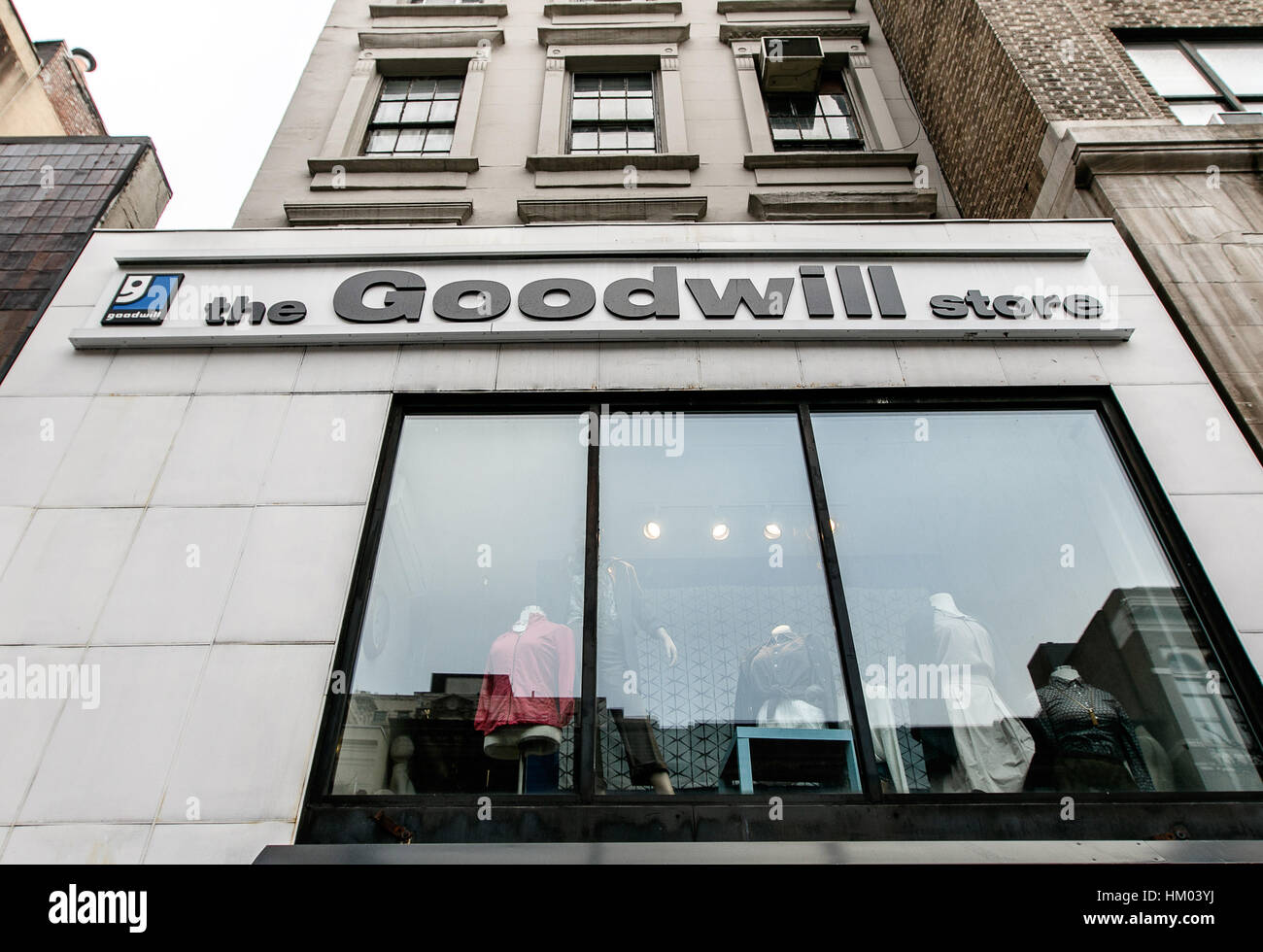 The front window of a Goodwill store west 72 street in Manhattan. - Stock Image