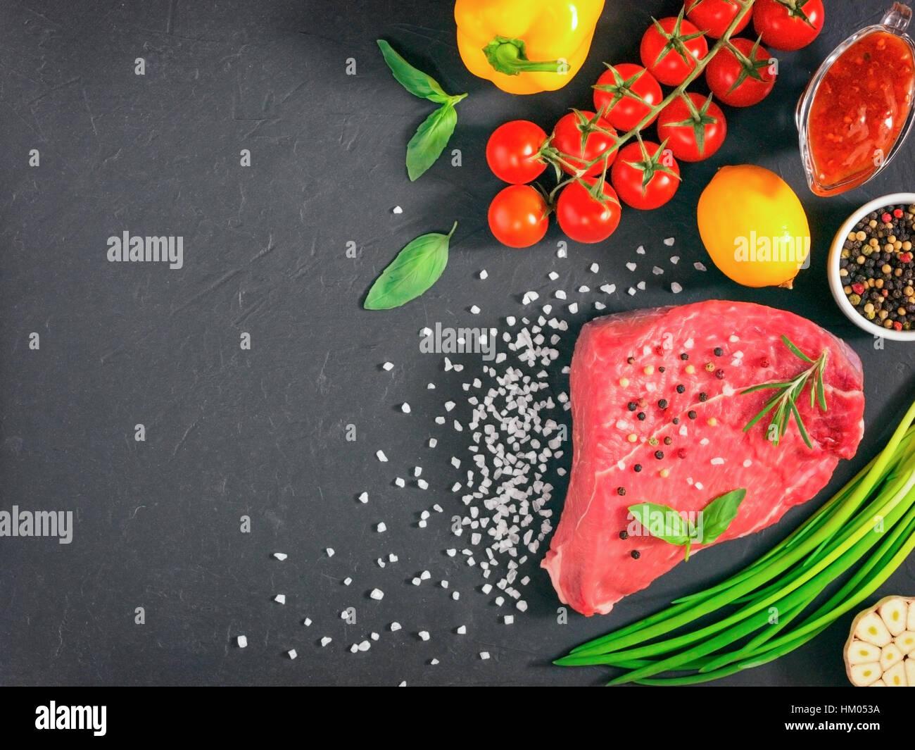 raw meat on dark background - Stock Image