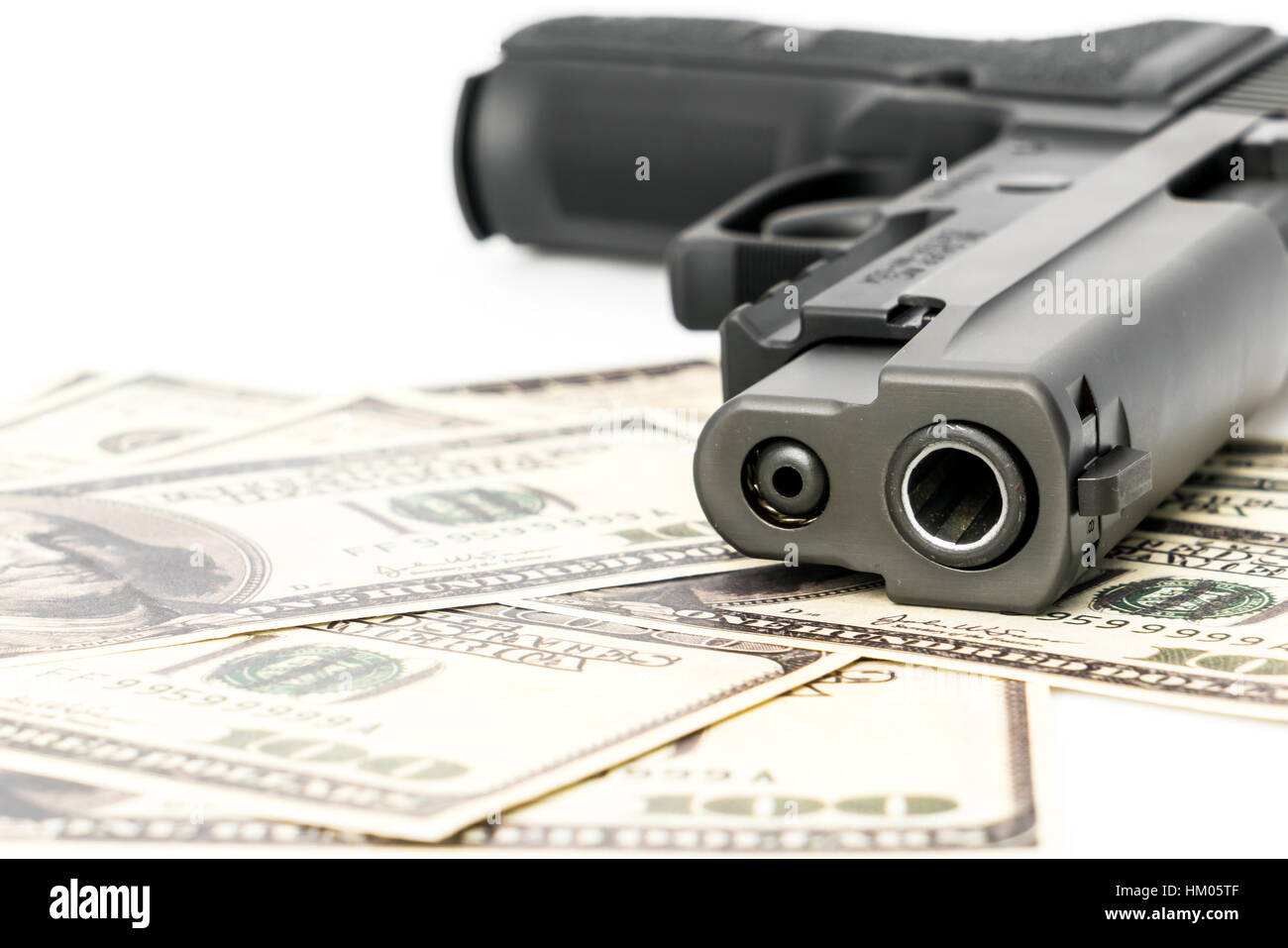 Close up image of pistol and dollar - Stock Image