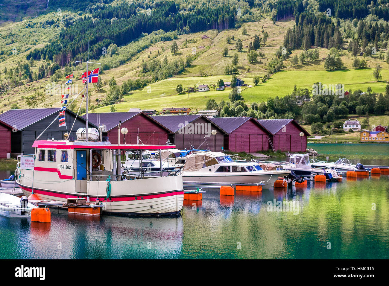 Boats Tied Up At Olden Norway - Stock Image