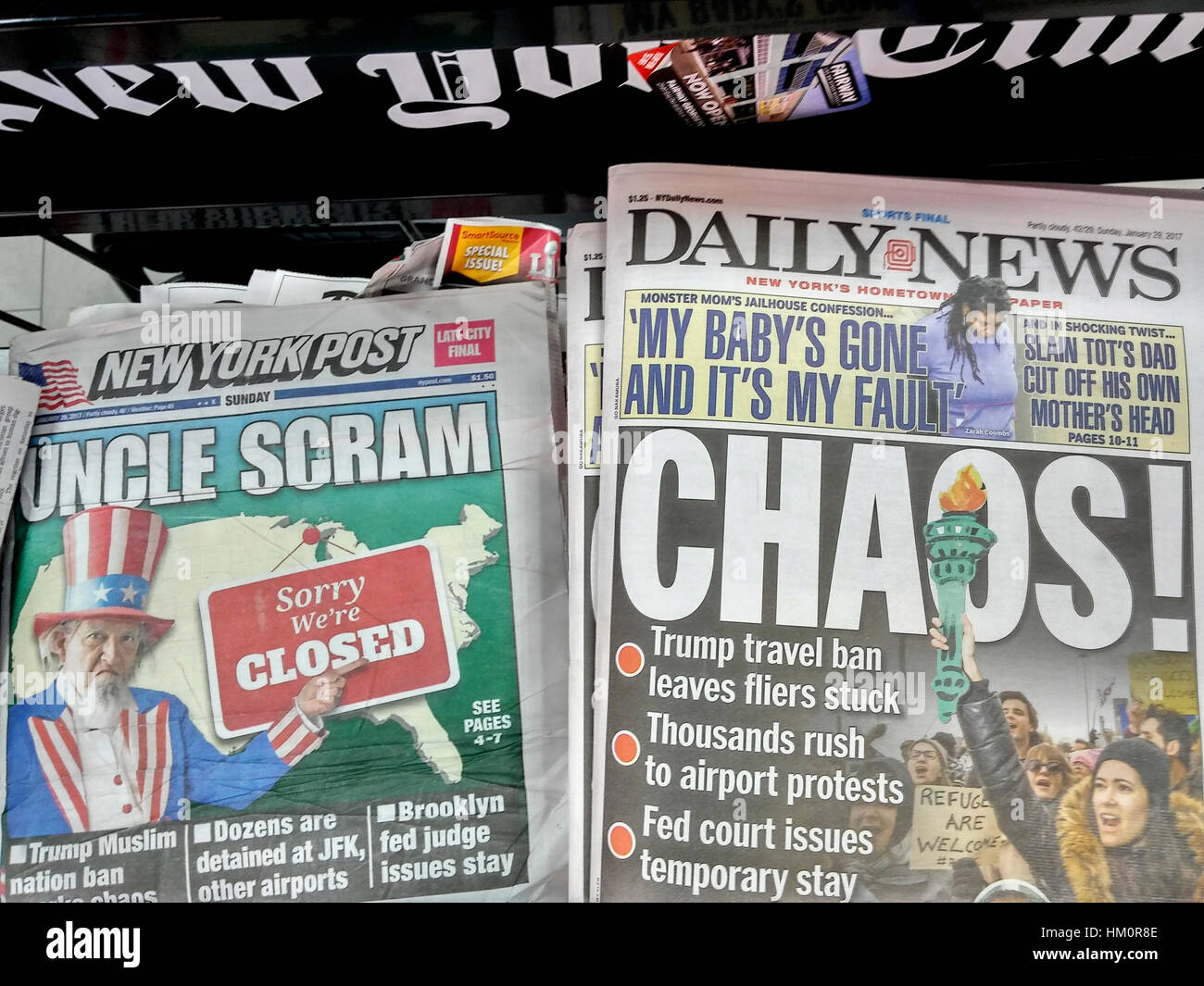 New York newspapers report on Sunday, January 29, 2017 on the previous day's protest involving President Donald - Stock Image