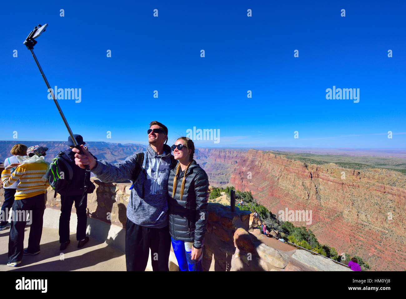 Couple taking selfy photographs, Grand Canyon National Park South Rim at Desert View Watchtower visitors viewpoint - Stock Image
