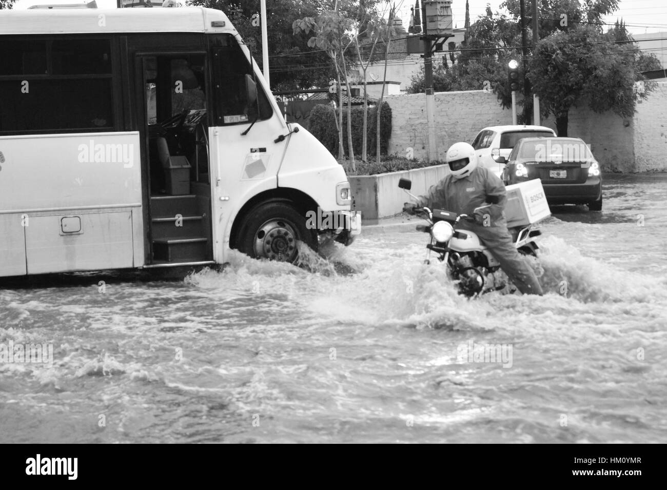 Truck and motorcyclist with helmet in flood Stock Photo