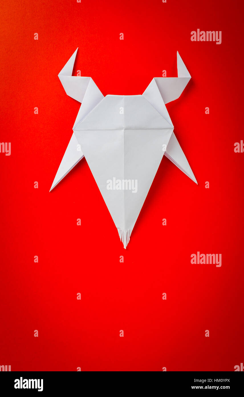 Origami paper goat on red background. New Year of the Goat 2015. - Stock Image