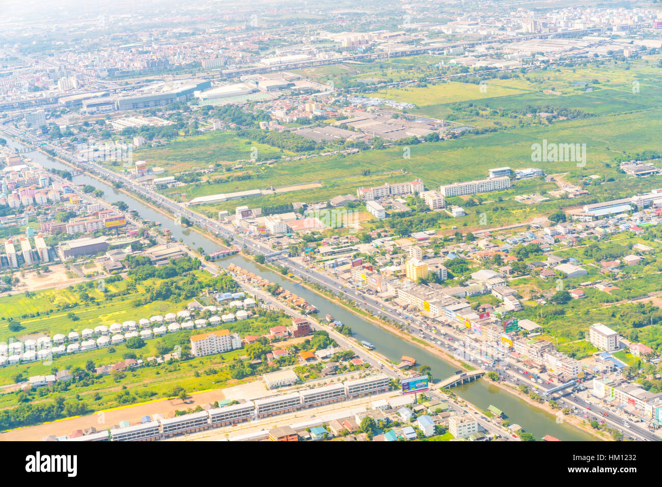 View of the ground from airplane window - Stock Image