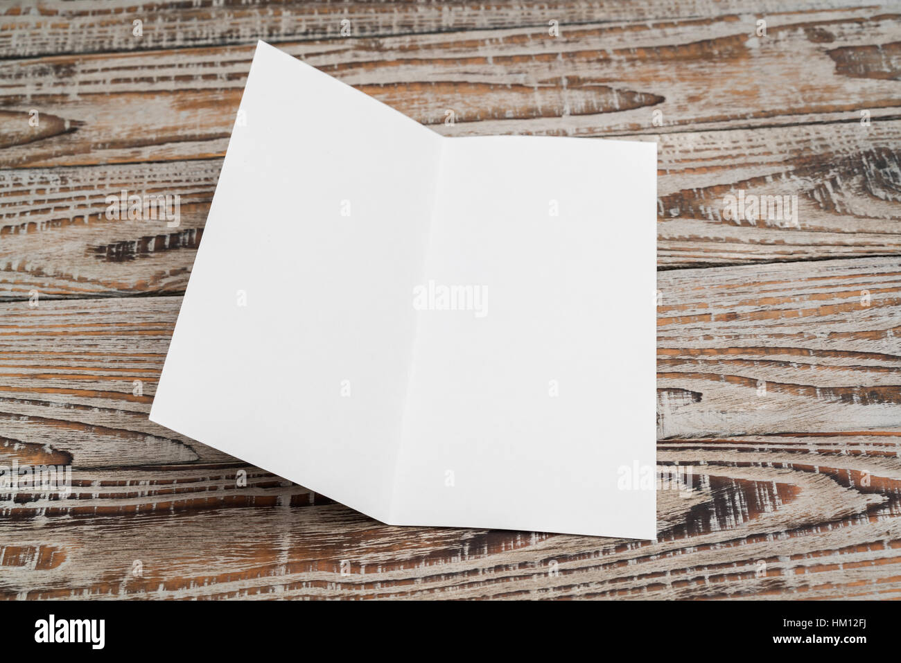 bifold white template paper on wood texture stock photo 132789654