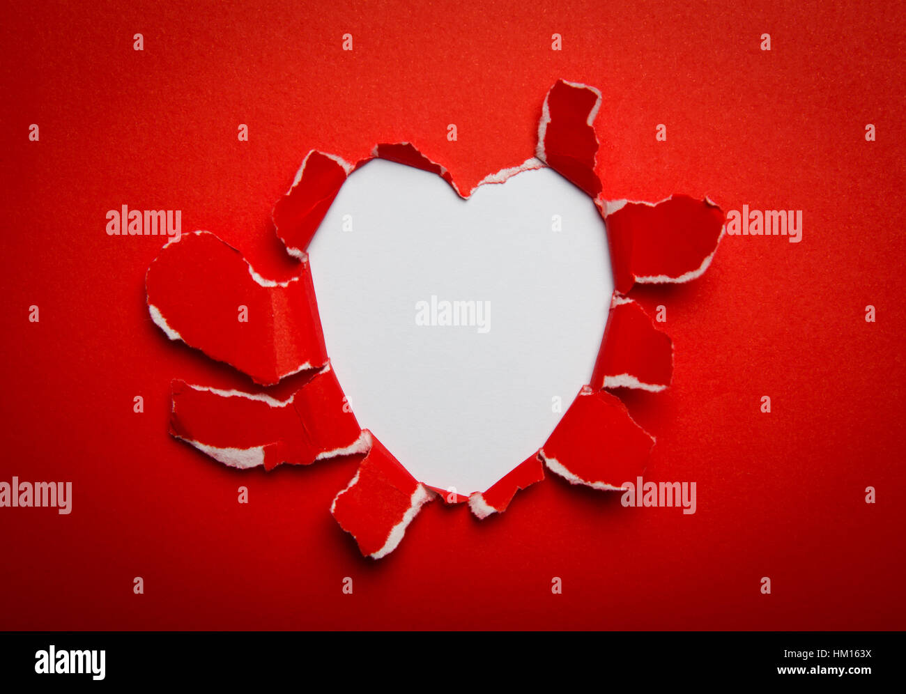 Heart Shape Hole Through Paper Symbol For Valentines Day With Stock