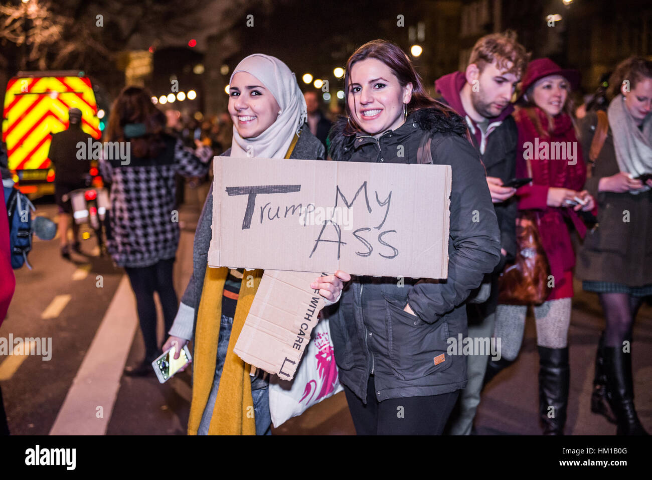 30th January, 2017. London. People attend a rally against US President Donald Trump's travel ban policy targeting - Stock Image