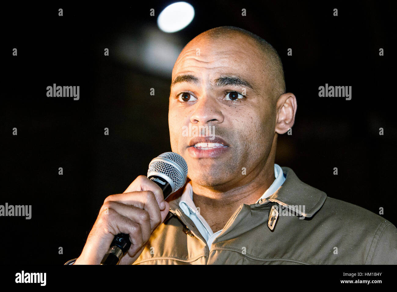 Bristol, UK. 30th January, 2017. Bristol Mayor Marvin Rees is pictured talking to protesters in College Green during - Stock Image