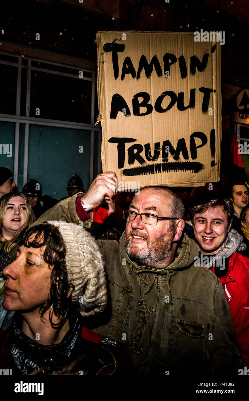 Cardiff, UK. 30th January, 2017. Protestors take to the streets in Cardiff, Wales to show opposition to American - Stock Image