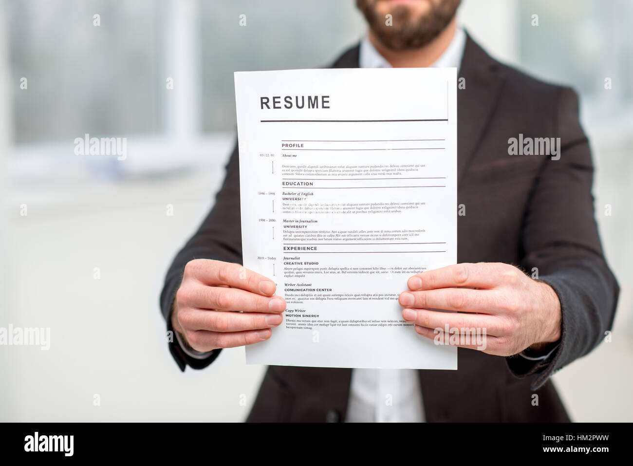 Man In The Suit Holding Resume For Job Hiring Close Up View Focused