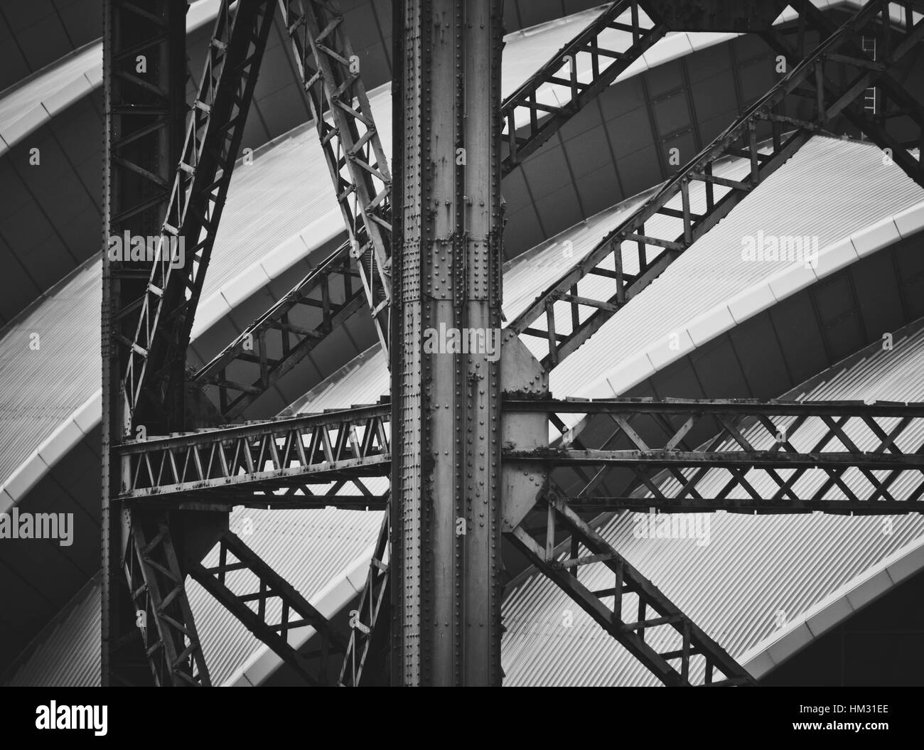 An Old Industrial Crane Against Modern Contemporary Architecture - Stock Image