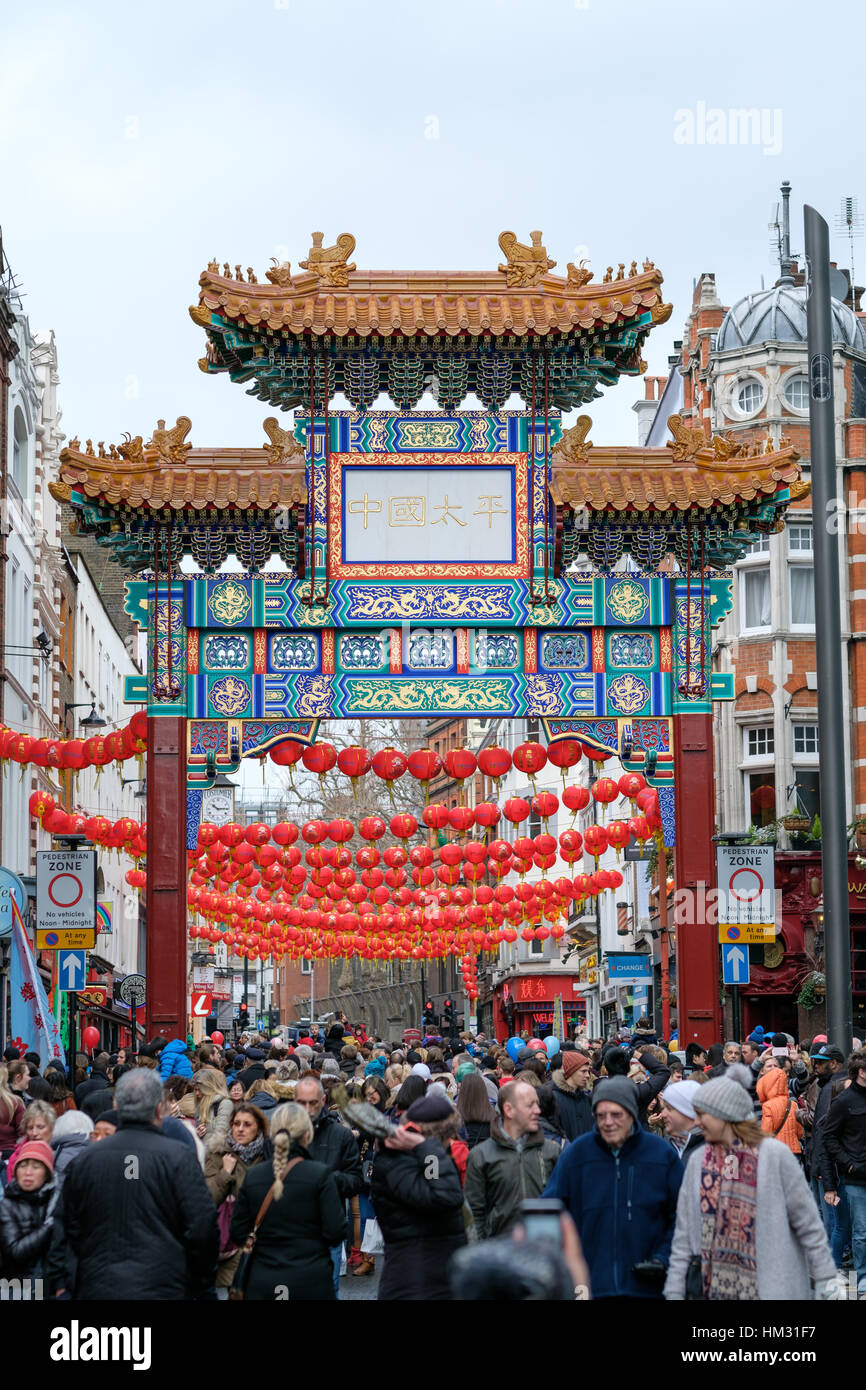 Chinese arch with red lanterns in London's Chinatown on Chinese New Year 2017 (year of the rooster) - Stock Image