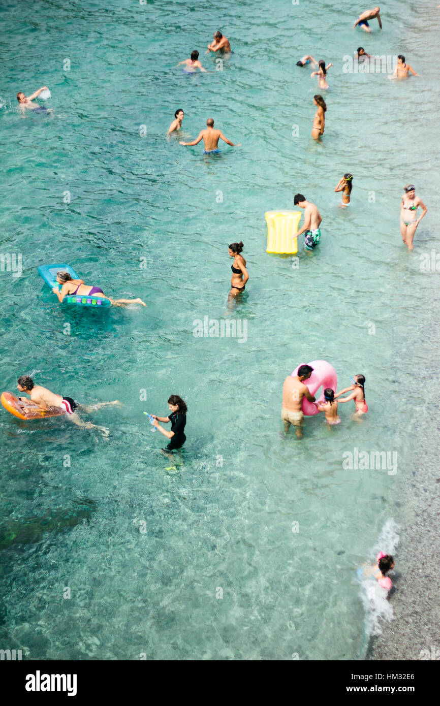 Aerial View Of People Swimming In The Aqua Sea With Inflatables At Monterosso Beach Cinque Terra Italy