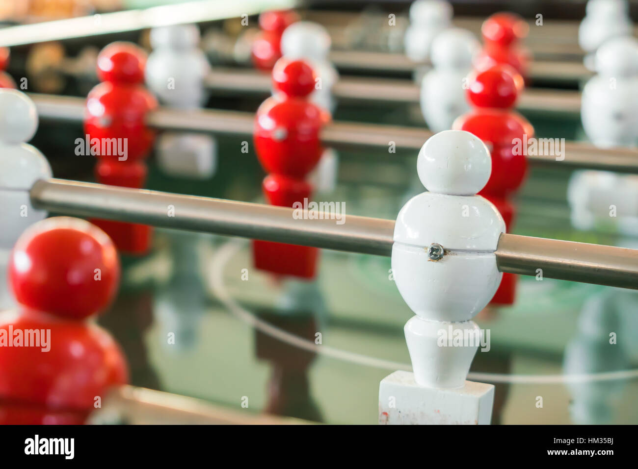 Football table game with red and white player - Stock Image