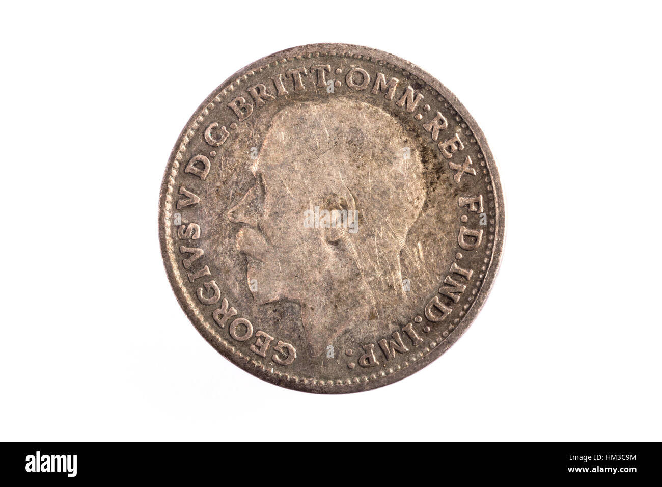 An Threepenny imperial coin with King George on the back - Stock Image