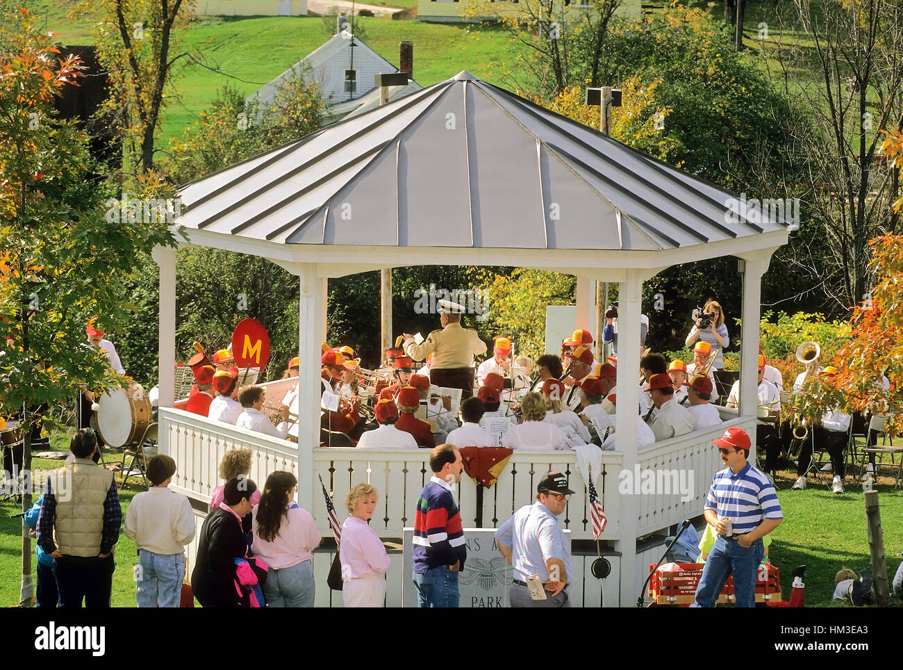 McLures Alumni Band play a concert under the band stand in Groton, VT, USA. Digital scan from slide. - Stock Image