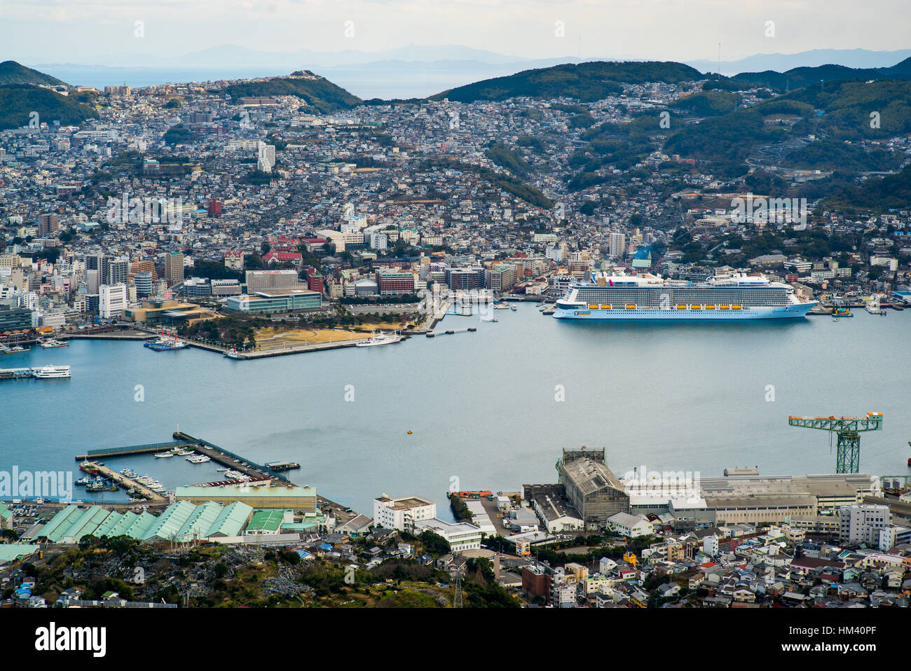 The MS Quantum of the Seas, a giant Quantum-class cruise ship operated by Royal Caribbean, sits docked in Nagasaki, - Stock Image