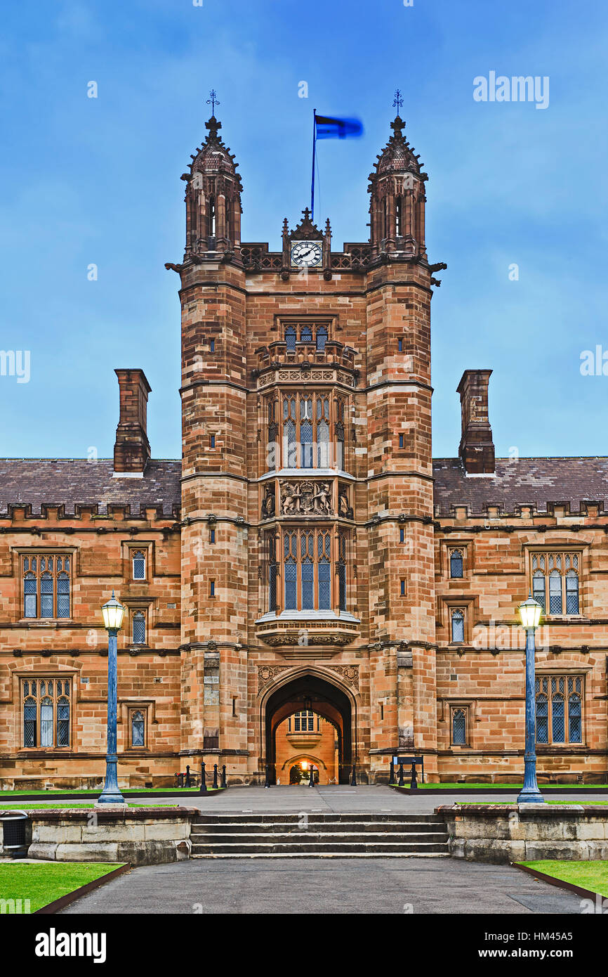 Facade of historic building of Sydney University. Entrance tower and gate to the inner courtyard of main faculty - Stock Image