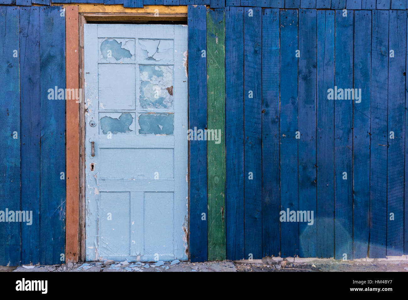 Old wooden light blue door in a dark blue wall. Wooden colored Stock ...