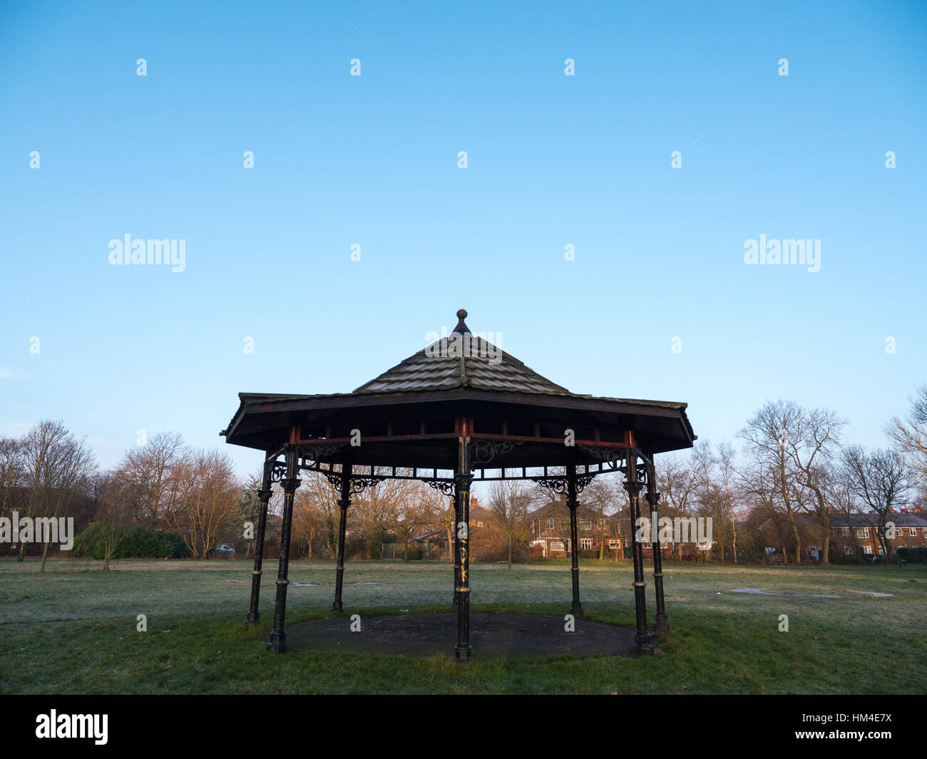 A vandalised victorian bandstand in a public park in Manchester - Stock Image